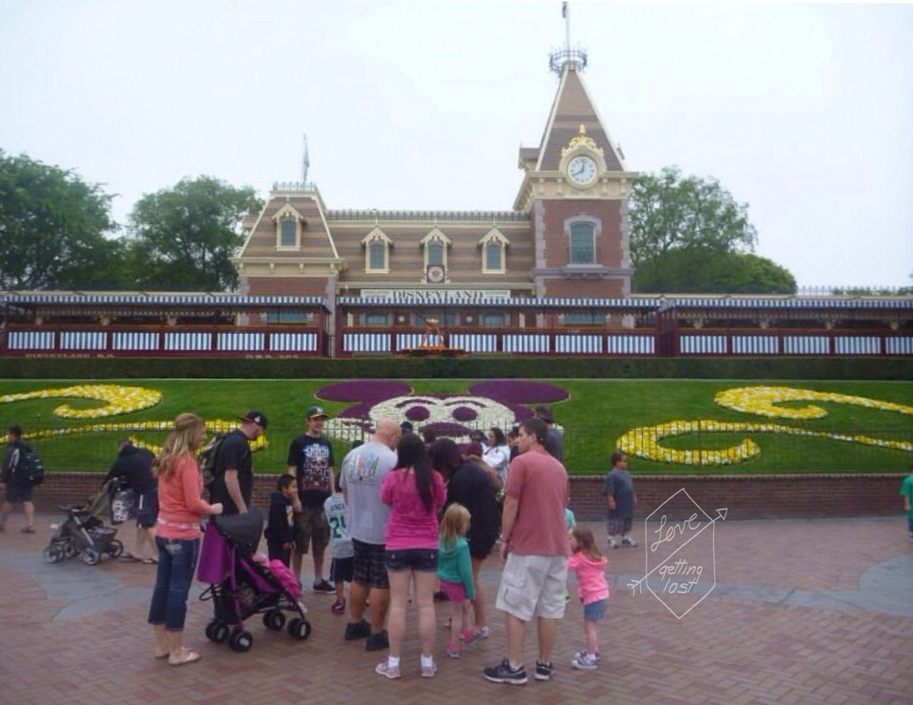 disneyland main entrance railway station with crowed