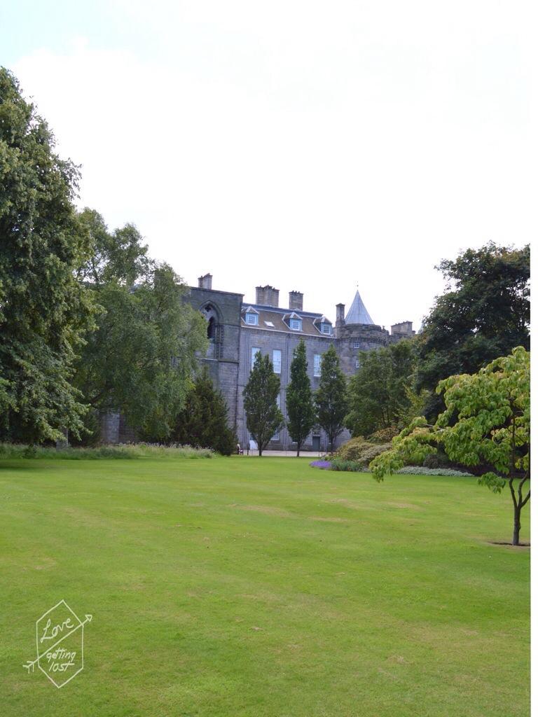 Holyrook palace and Abbey through the trees, edinburg, scotland, united kingdom