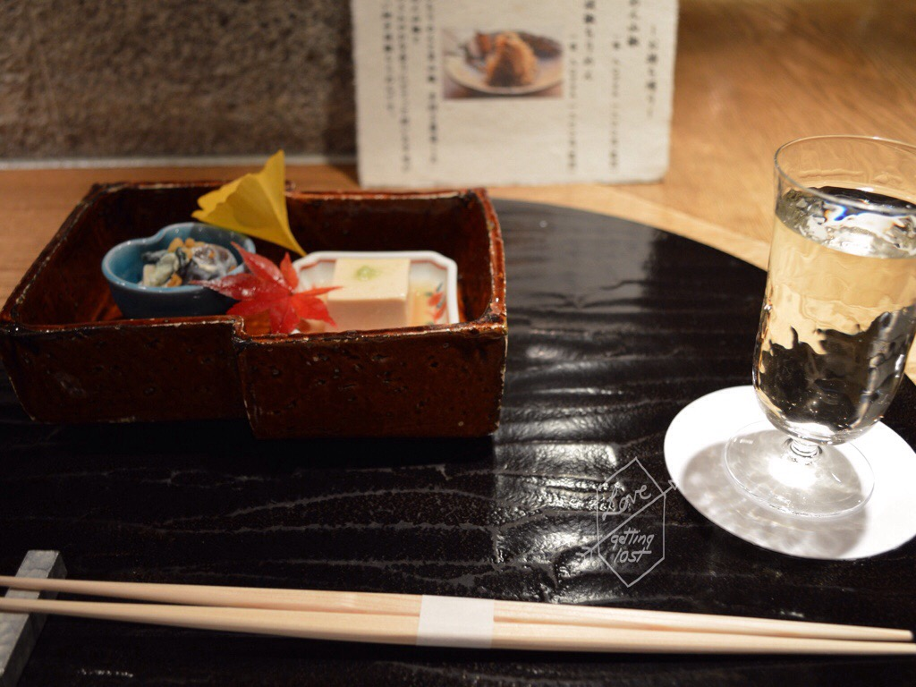 The kitchen view in Gion Karyo, Garland chrysanthemum and mushroom tofy salad and peanut tofu. Gion, Kyoto, Japan